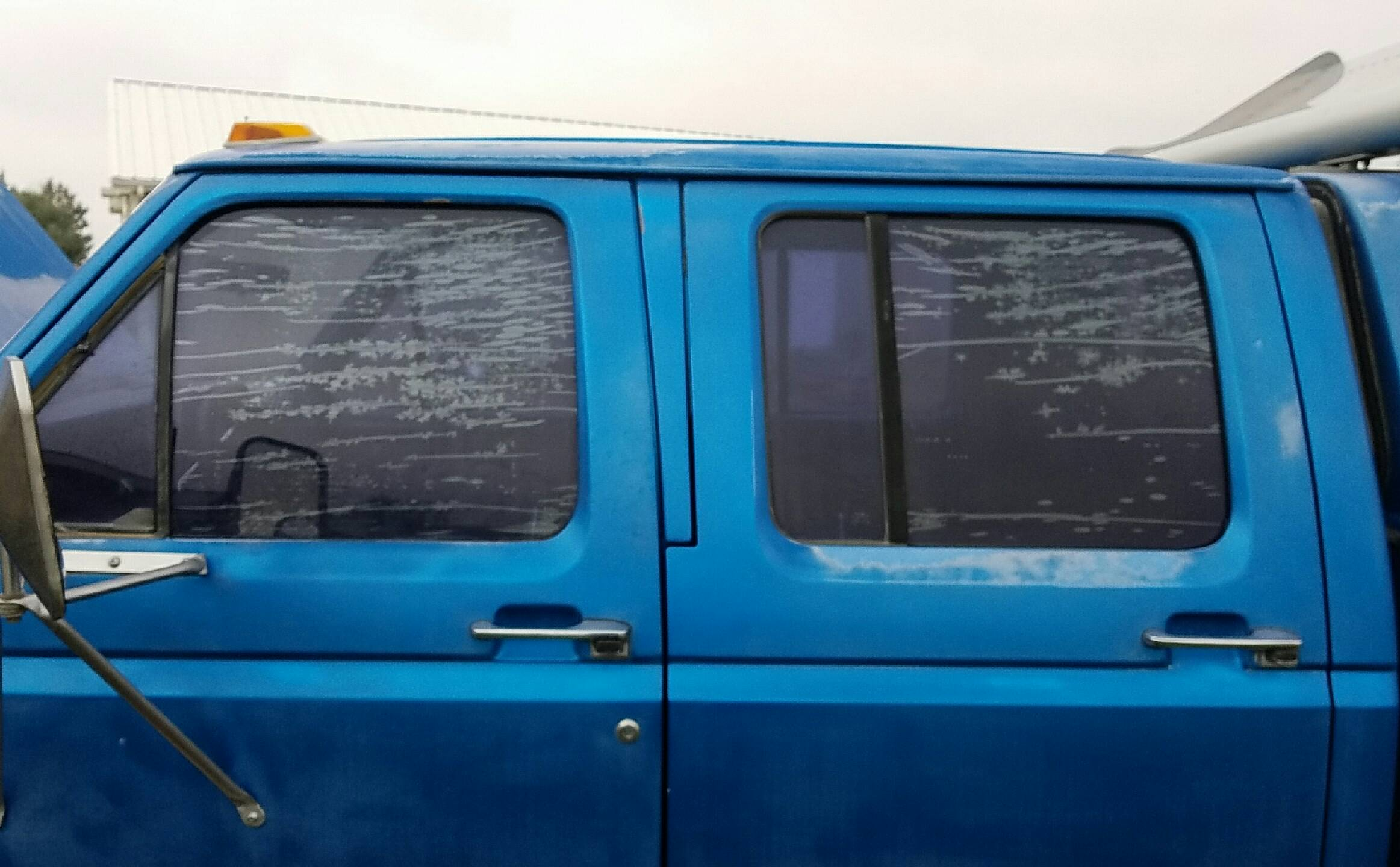 Old purple and Failed window tint before removal